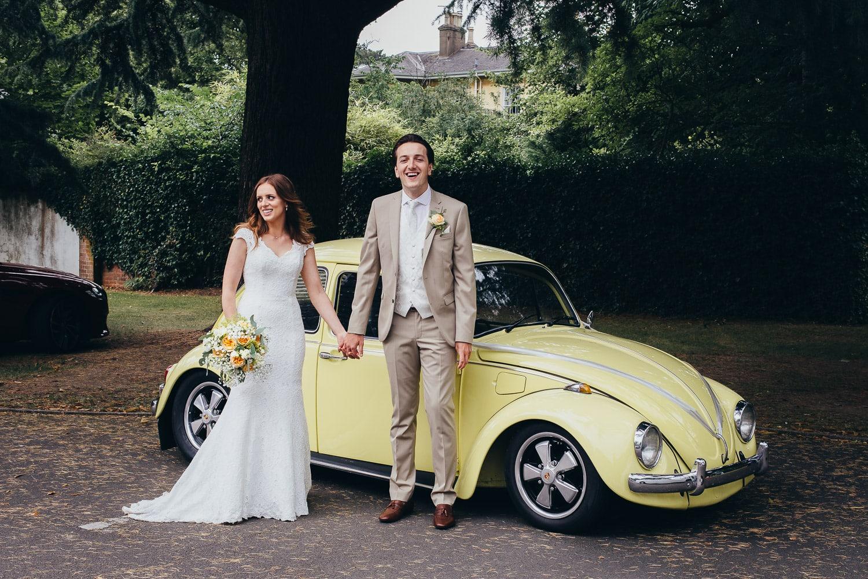 bride and groom with retro volkswagen