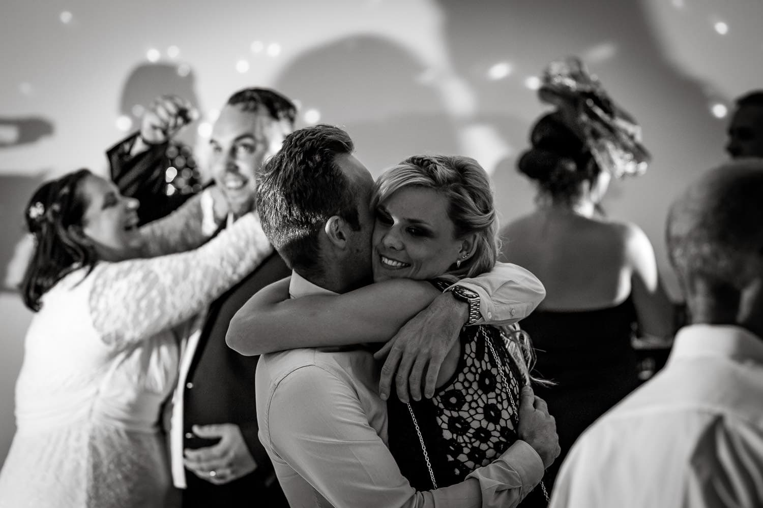 couple laugh on dance floor at warwick house wedding