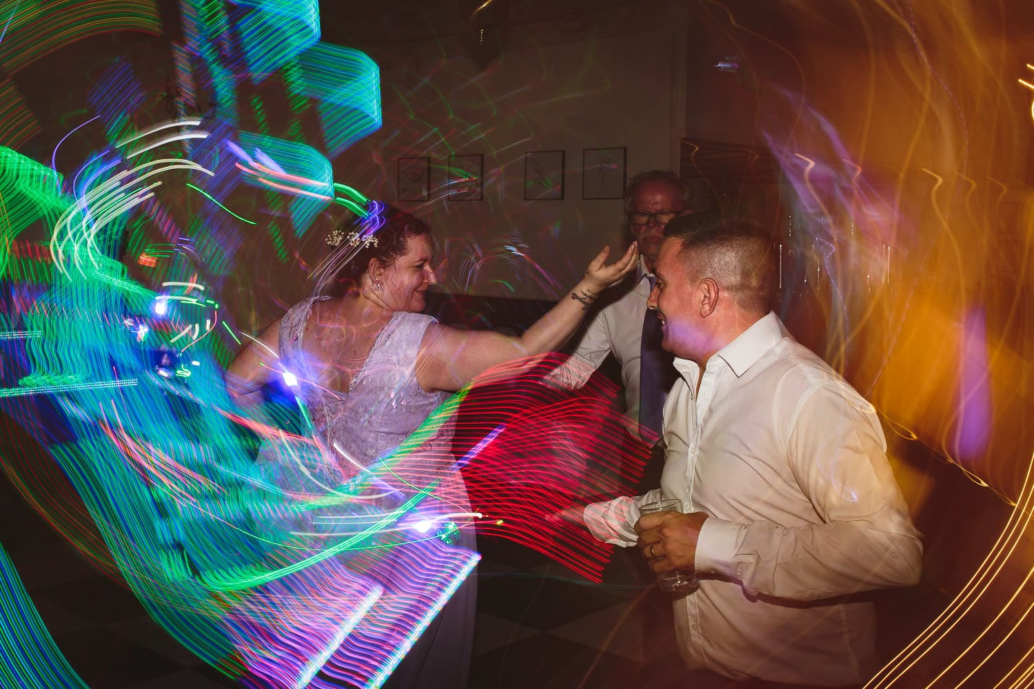guests get crazy on the dance floor at Warwick House wedding