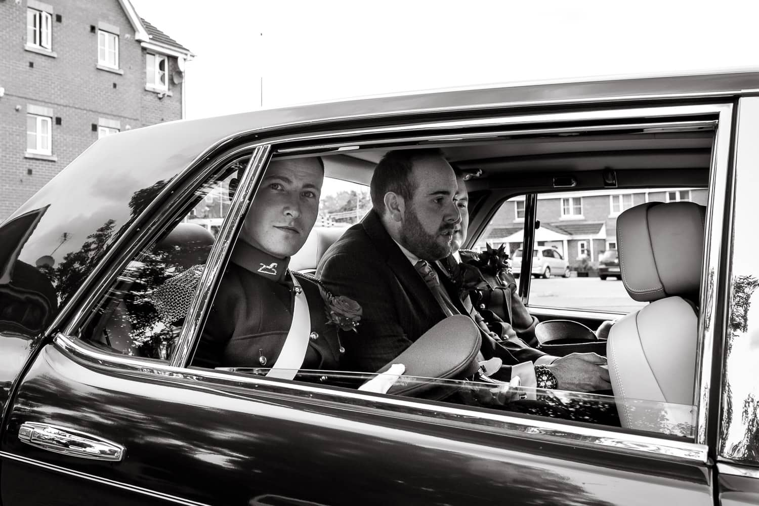 groom leaves for wedding ceremony in car by chapter one photography