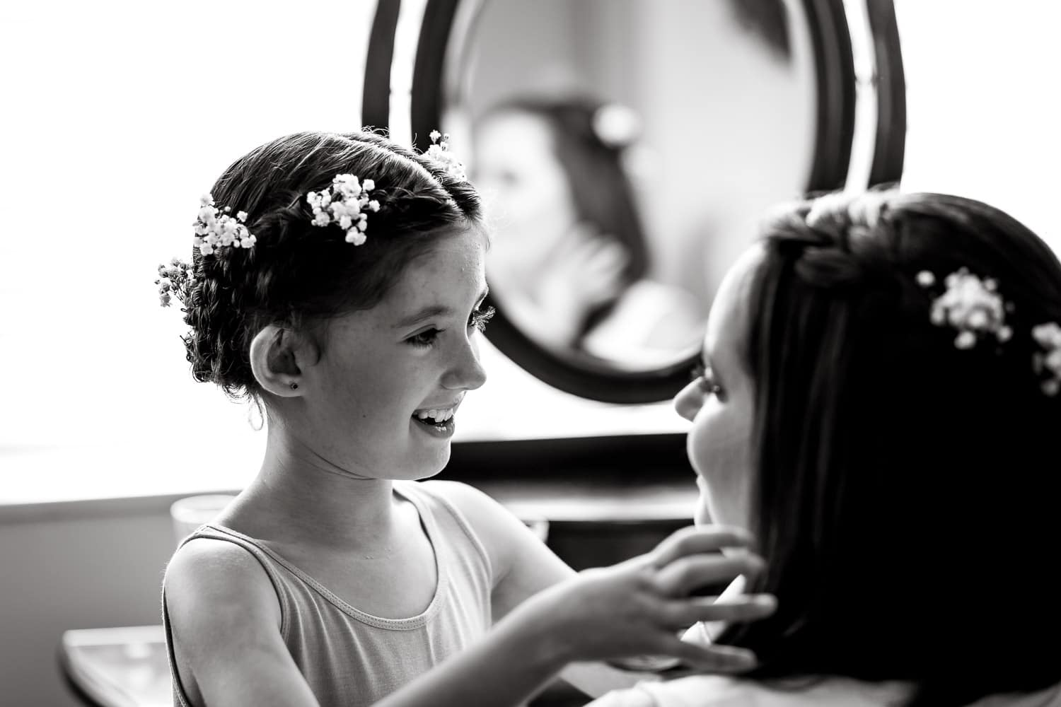 bride and niece share a sweet moment before warwick house wedding