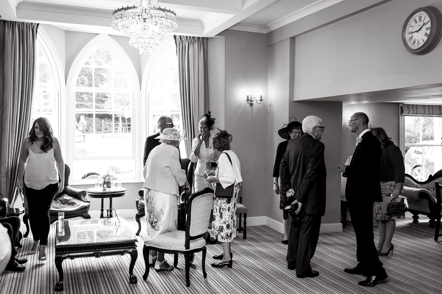 warwick house wedding guests mingle before wedding ceremony