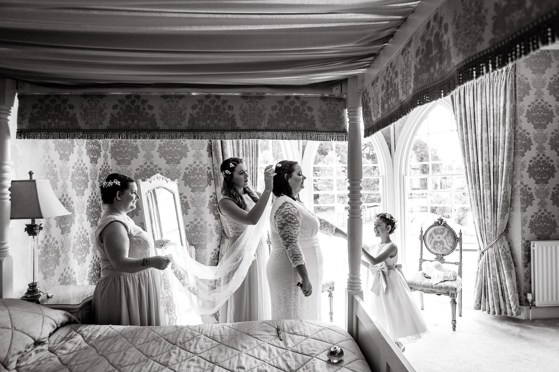 final adjustments to brides veil at warwick house wedding