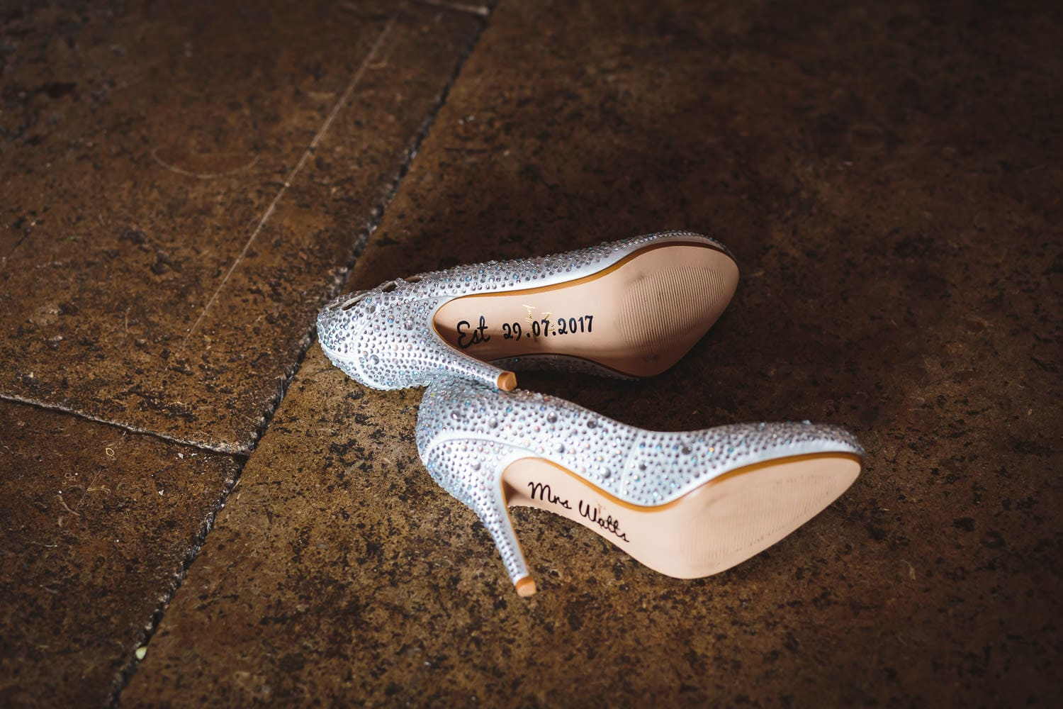 wedding shoes with brides name on by chapter one photography
