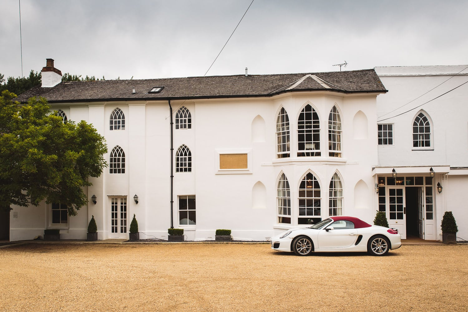 porsche parked outside warwick house wedding venue ready to whisk away newlyweds
