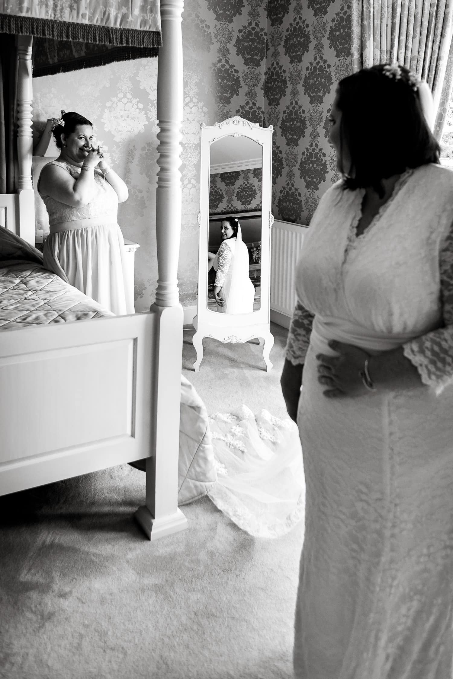 sister admires the beautiful bride at warwick house wedding in warwickshire