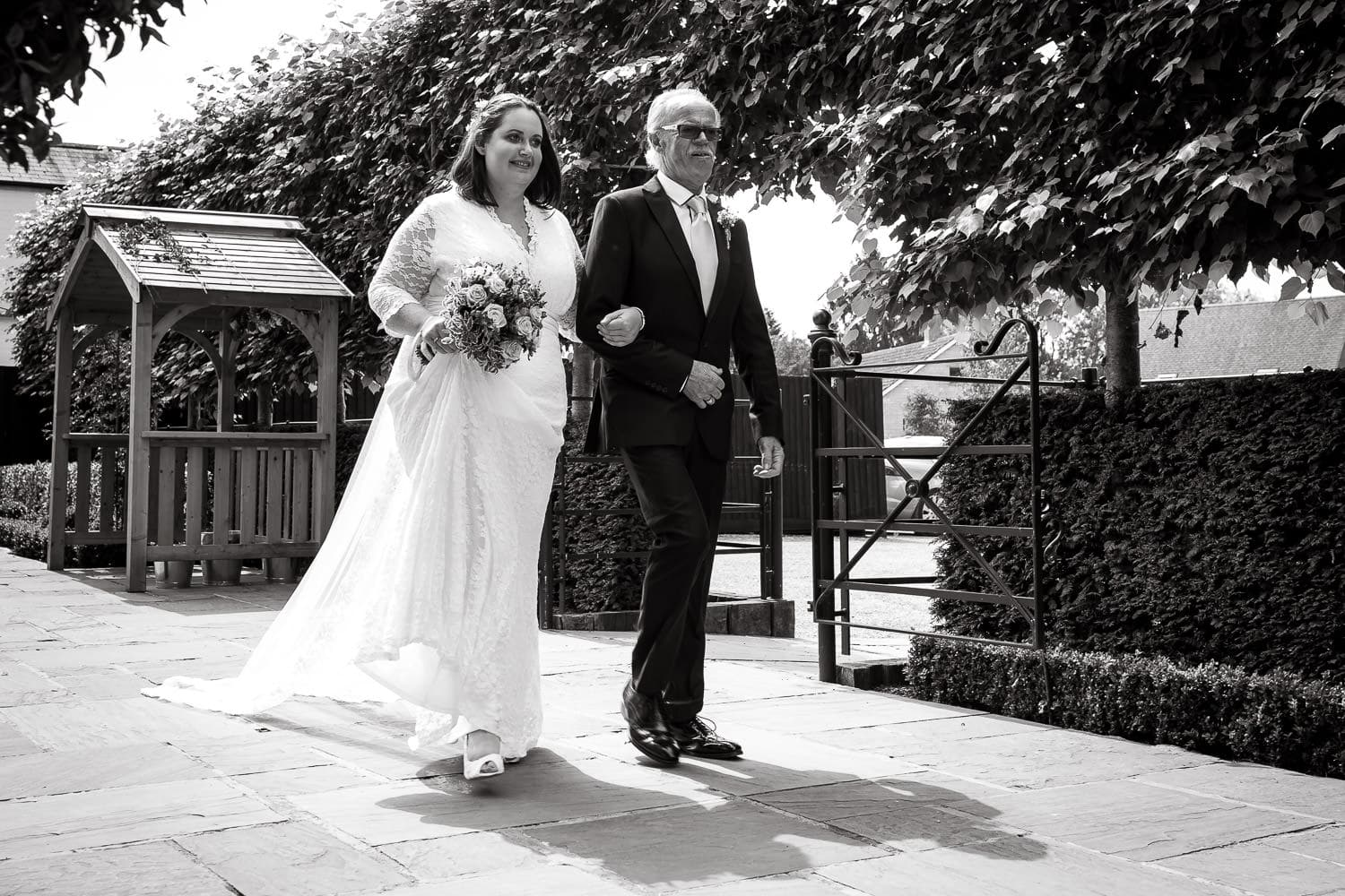 dad walks daughter down the aisle to waiting groom during warwick house wedding