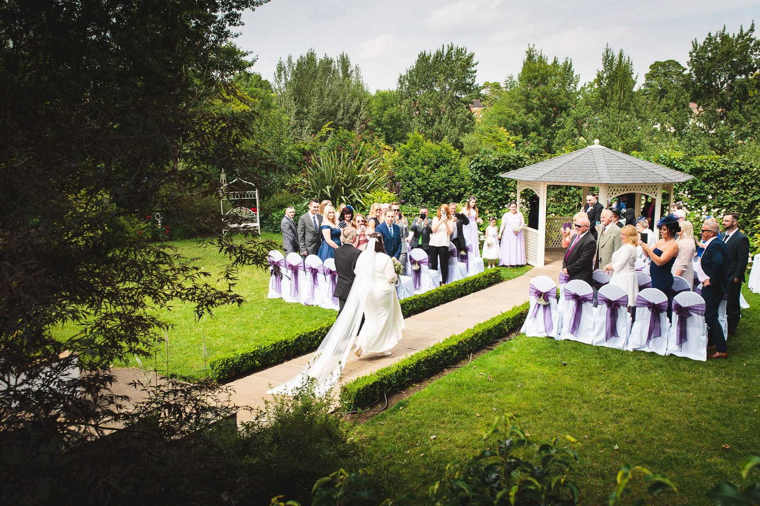 dad and daughter walk down the aisle at warwick house wedding