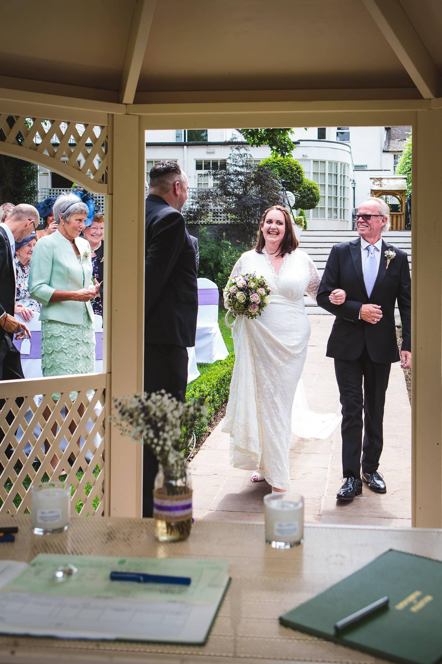 proud dad walks daughter down the isle at warwick house wedding