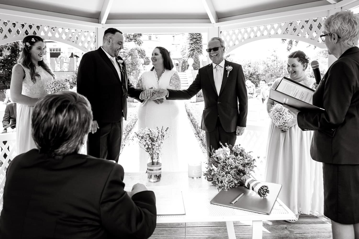 Dad hands daughters hand to groom during ceremony at warwick house wedding