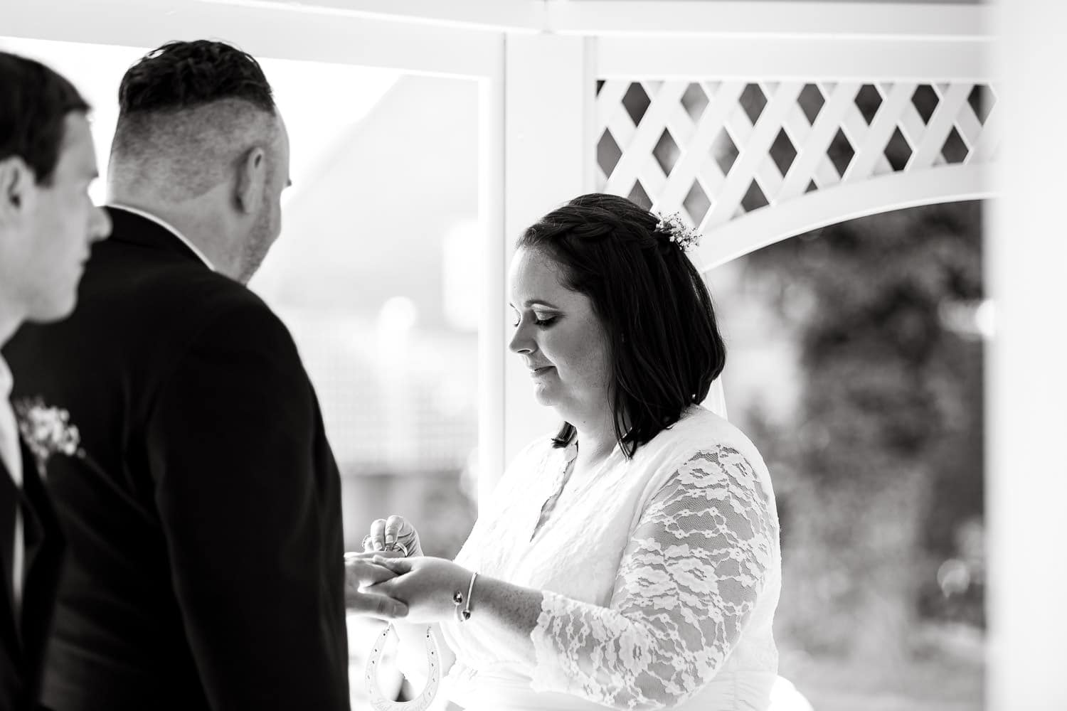 bride and groom exchange rings during warwick house wedding ceremony