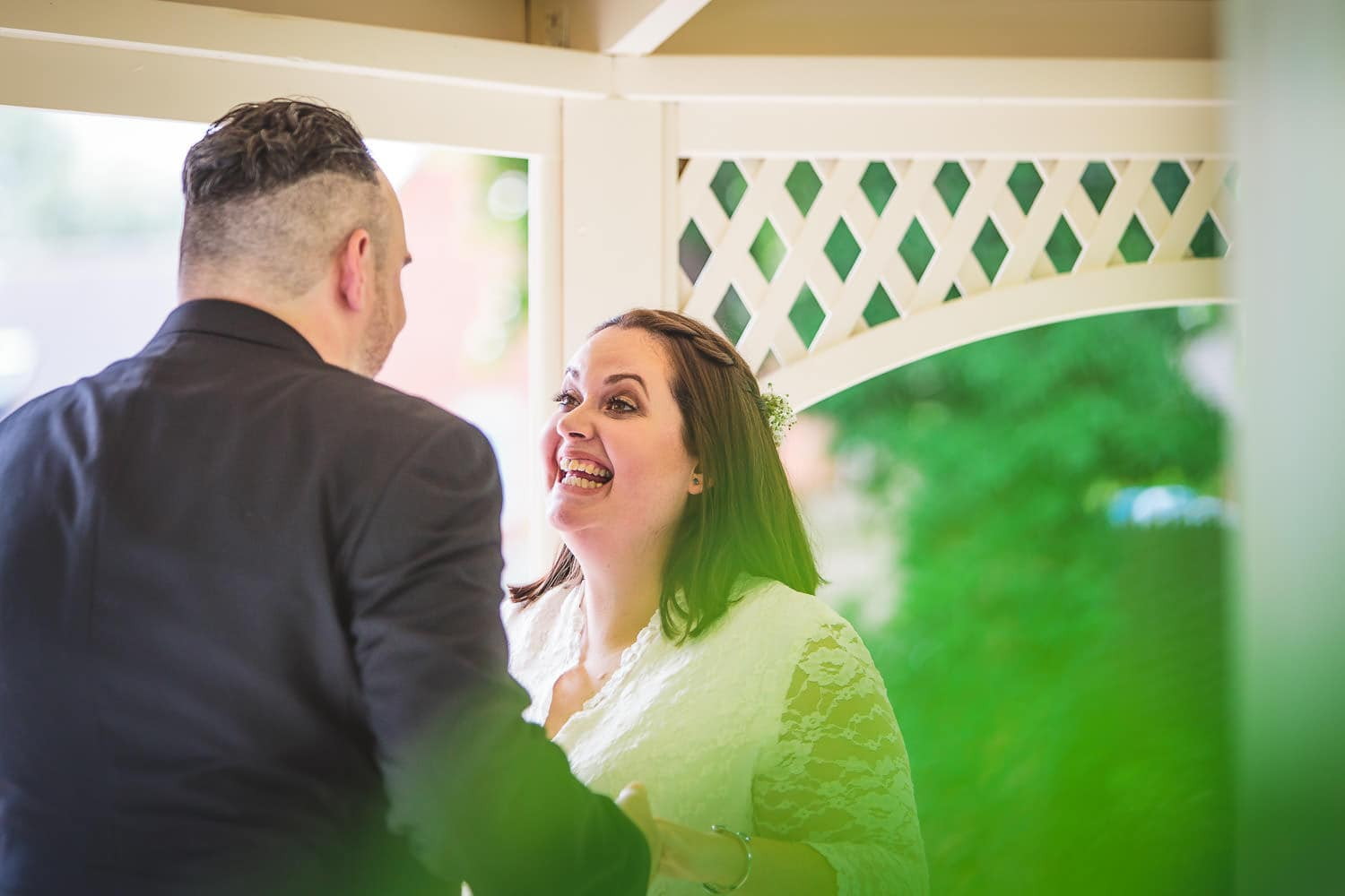 bride smiles nicely at groom during warwick house wedding