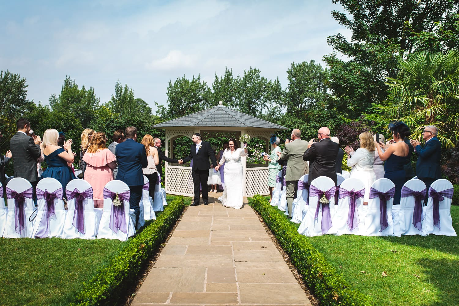 warwick house wedding ceremony is over and couple walk down aisle