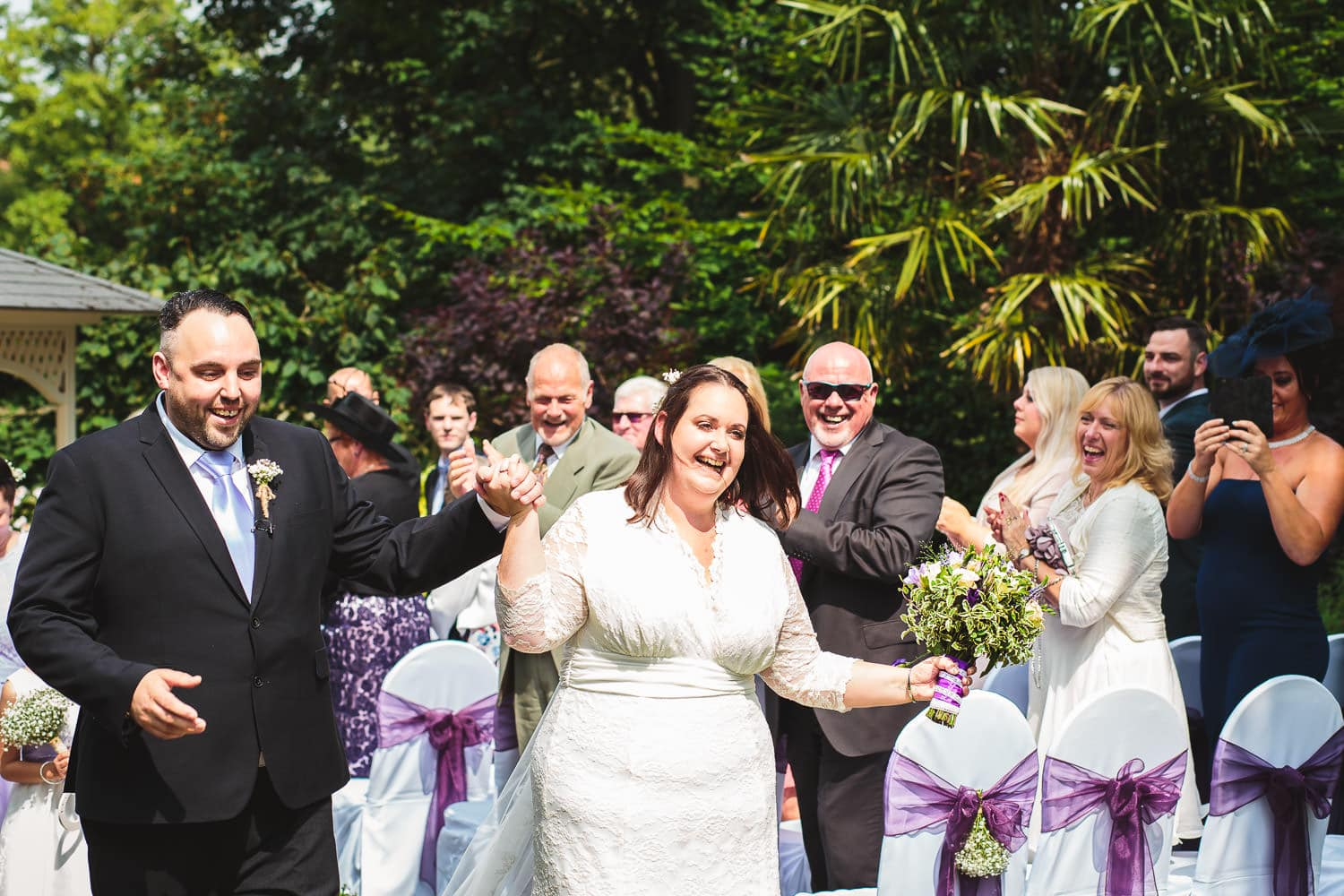 warwick house wedding guests smile nicely at couple