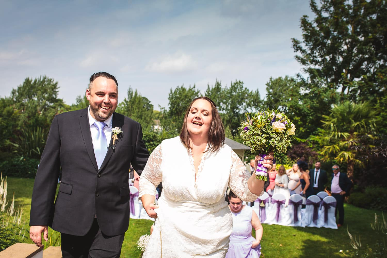 bride and groom after ceremony at warwick house wedding