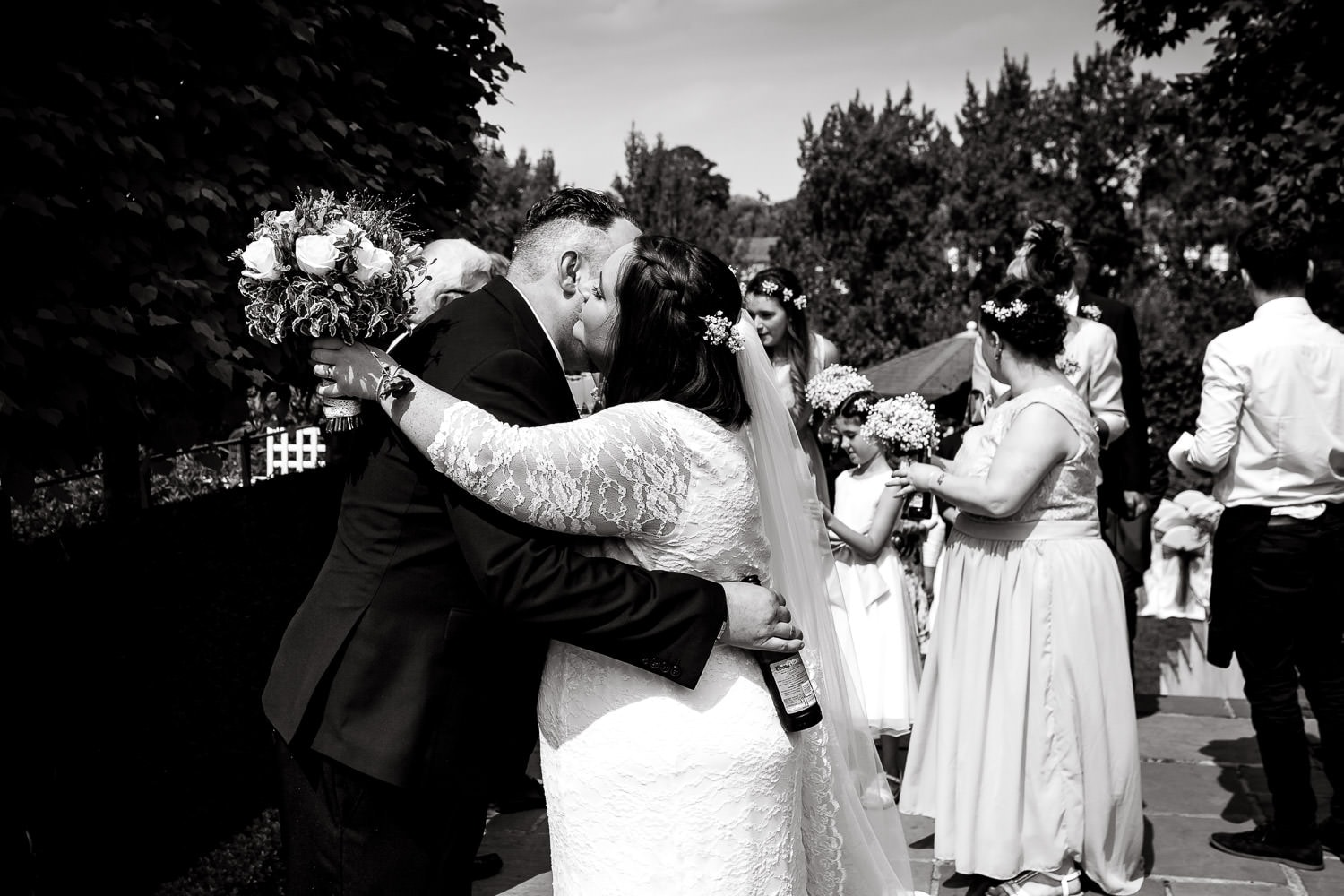bride and groom give each other a big hug after warwick house wedding