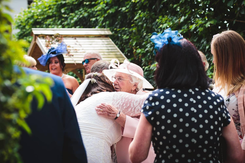 bride give nan a big hug at warwick house wedding in great britain