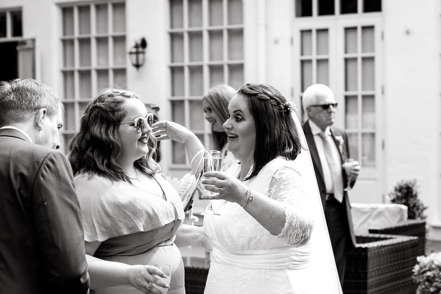 guests congratulate bride after ceremony at warwick house wedding in UK