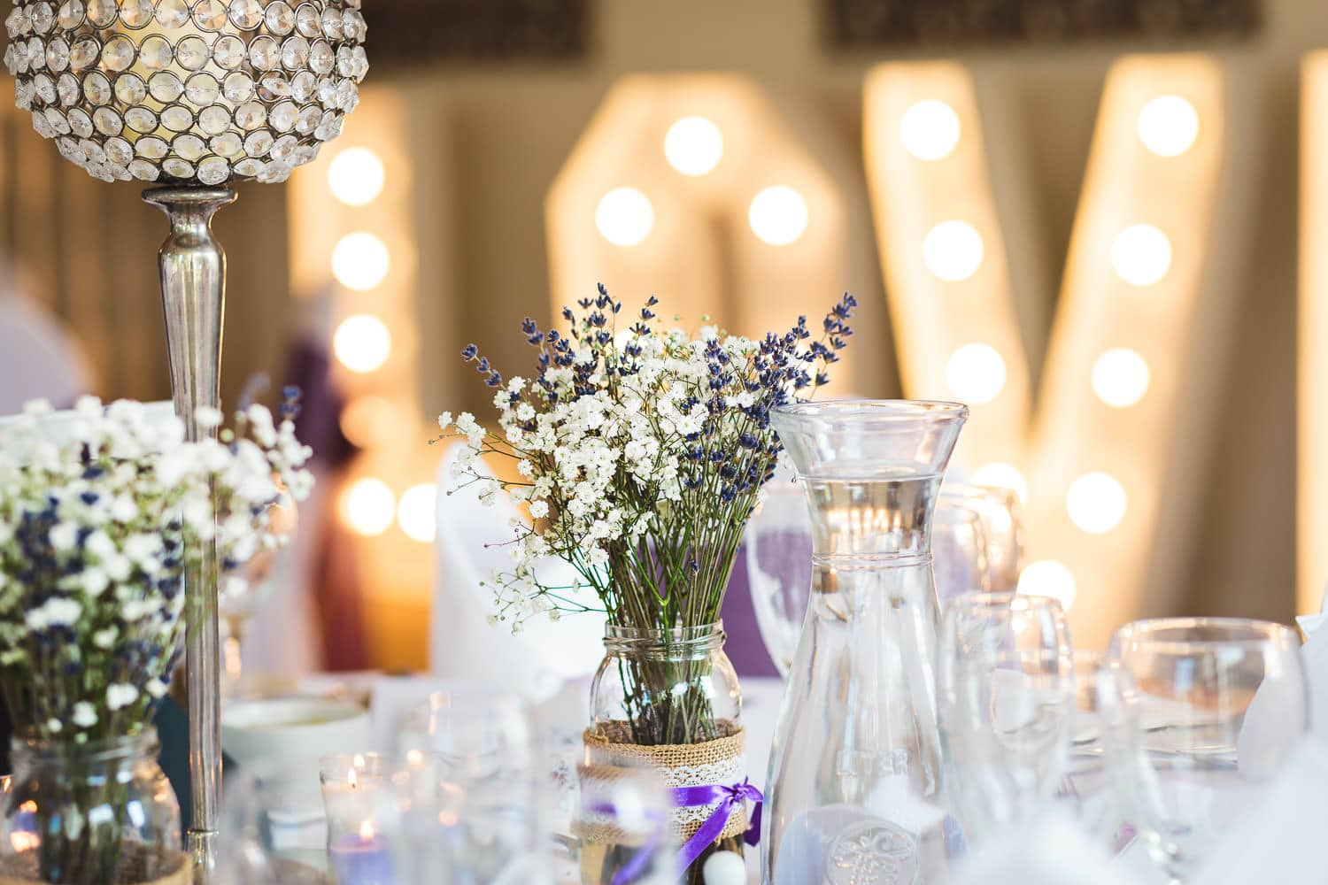 table decor and flowers at warwick house wedding in southam