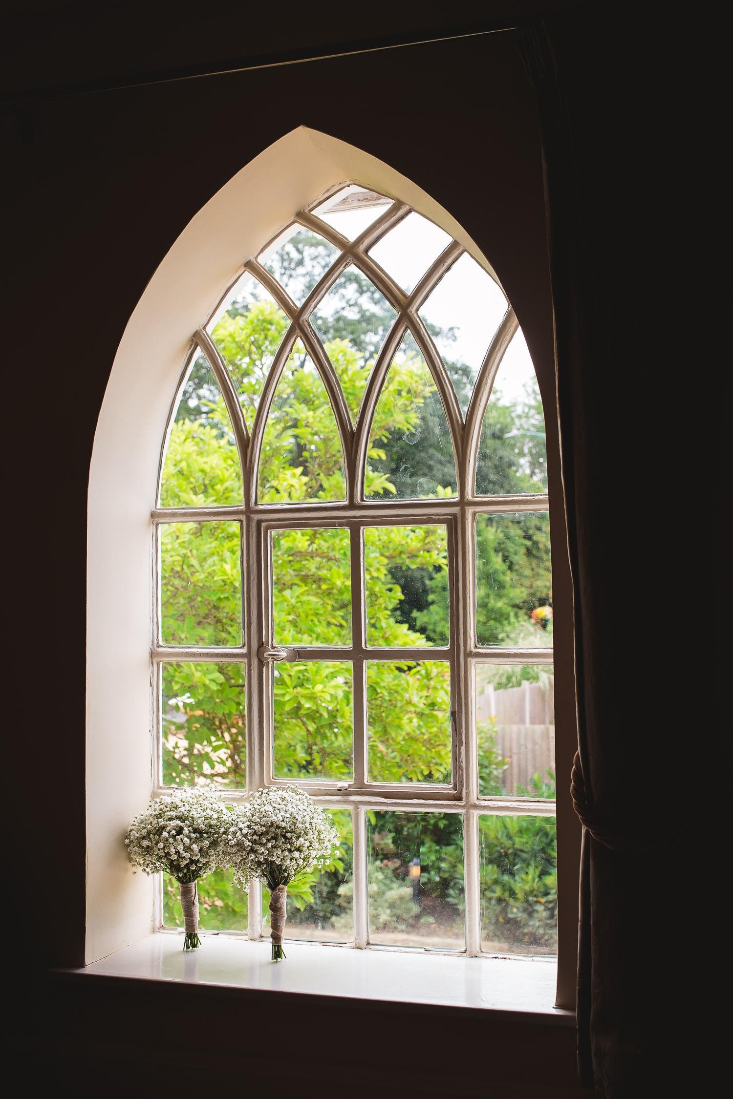 babys breath boquest backlit by window in warwick house wedding venue