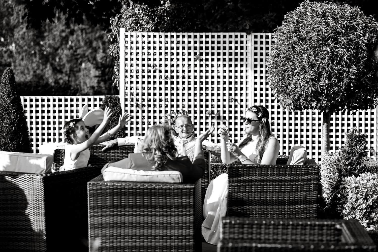 Guests bathing in natural lights of terrace at warwick house wedding