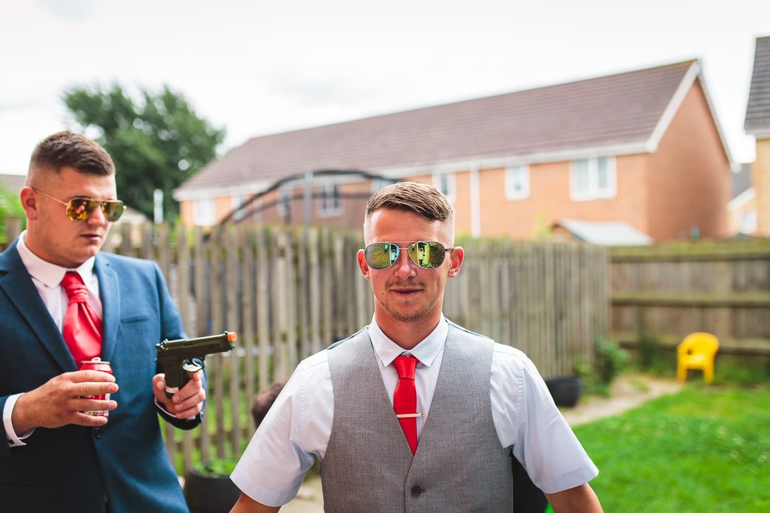 funny candid wedding picture of grooms party messing around by chapter one photography
