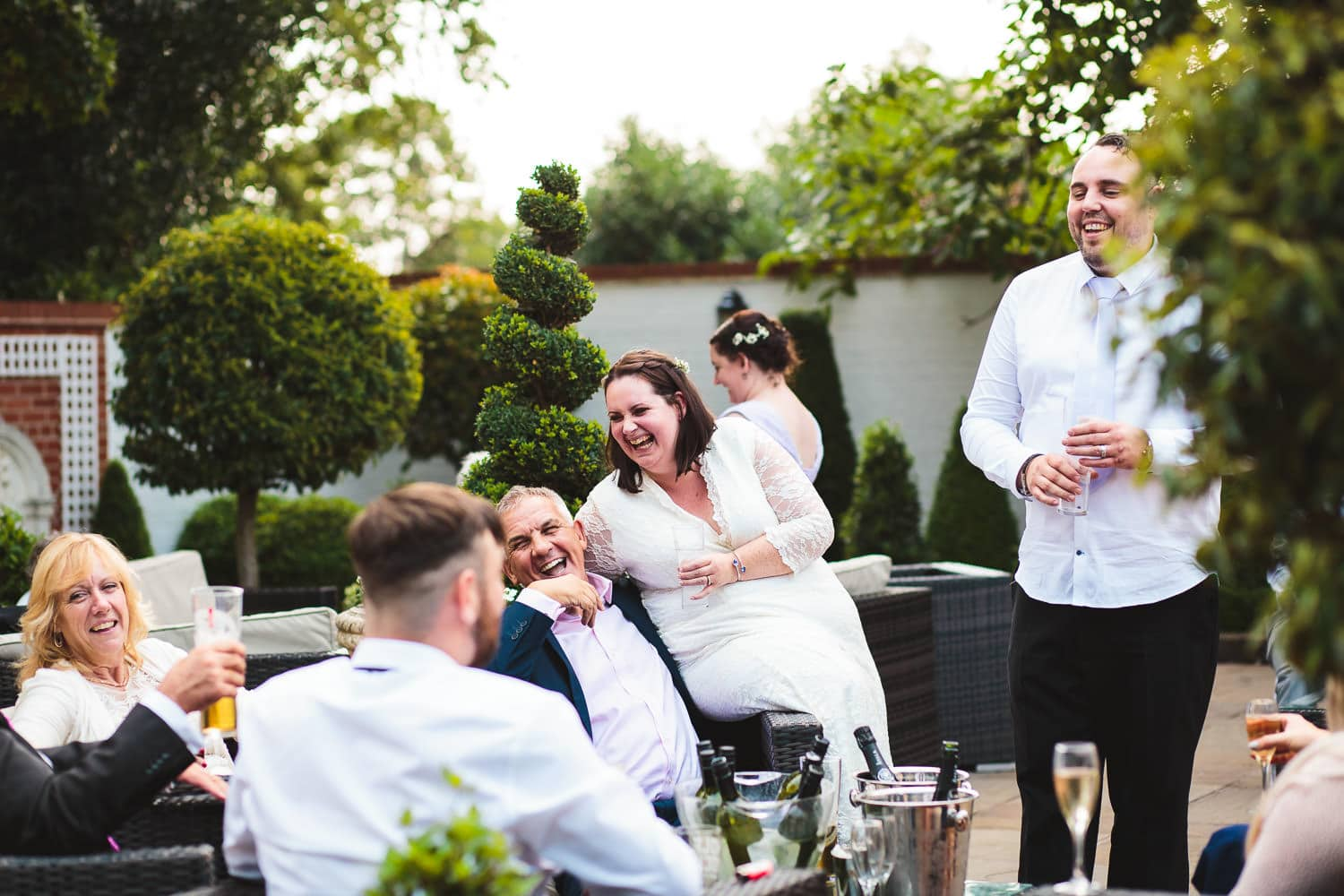 happy smilingguests on terrace at warwick house wedding in Southam