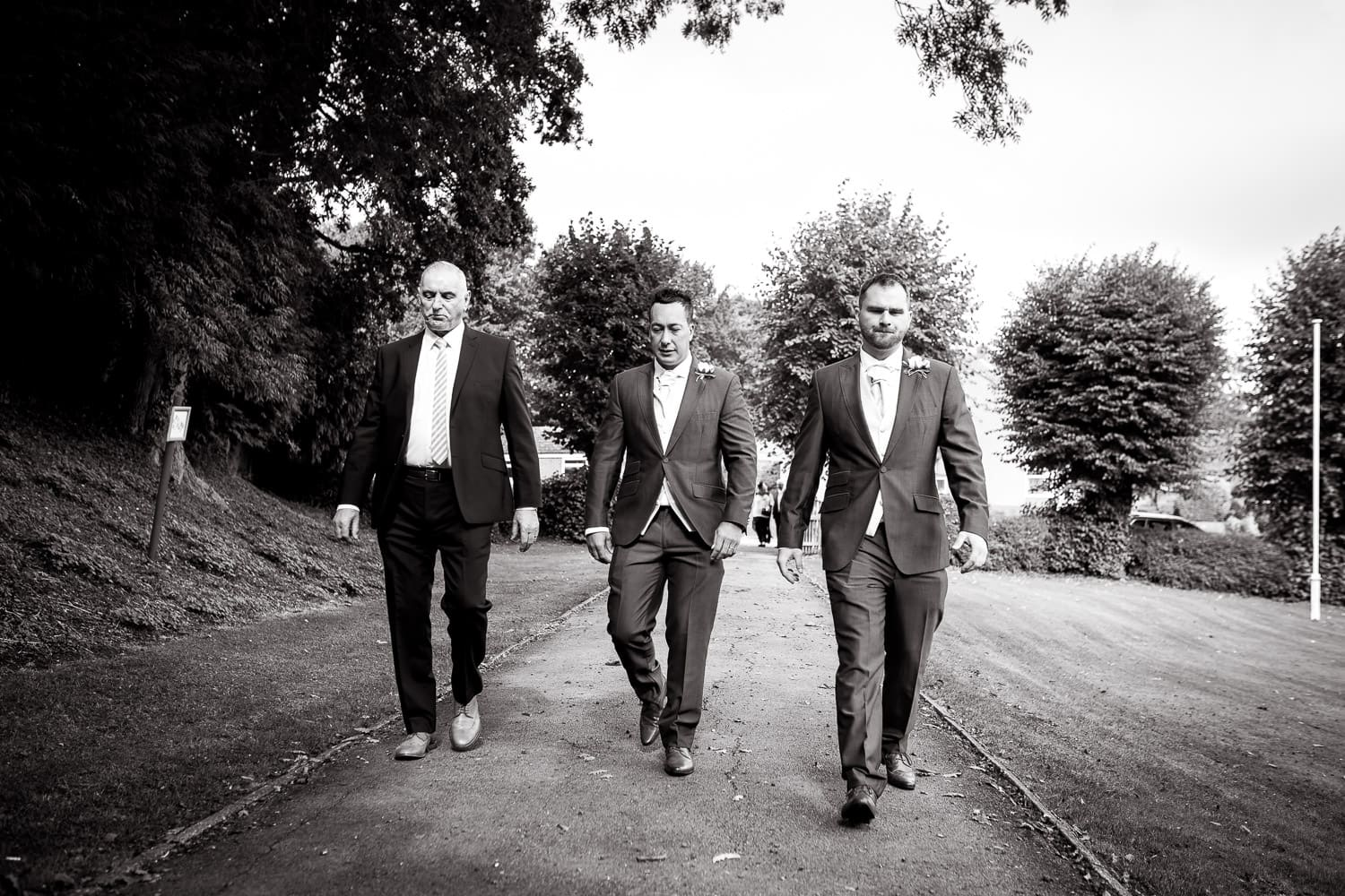 Grooms party march to the ceremony