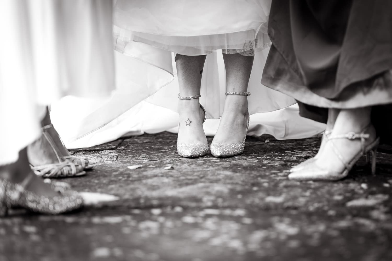 bride poses with a beautiful pair of chimmy choo shoes