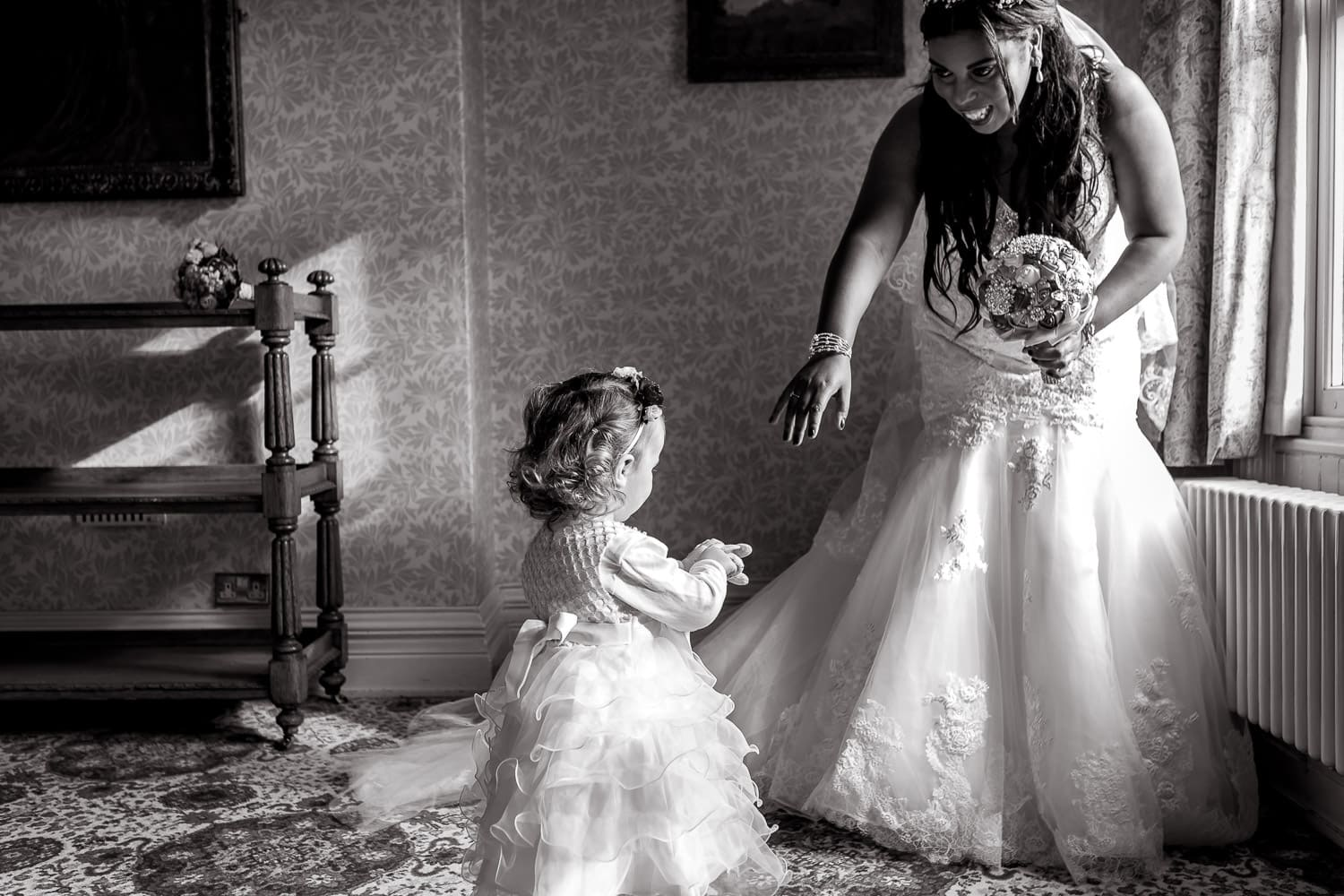 bride and flower girl play together