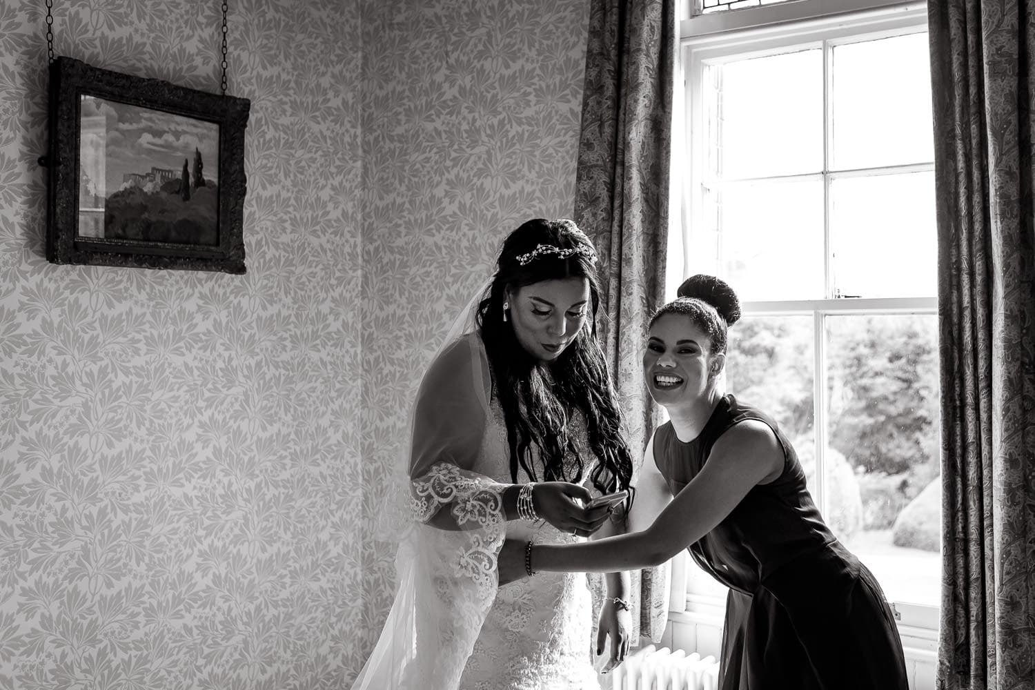 bride and sister share a fun moments before wedding ceremony in birmingham