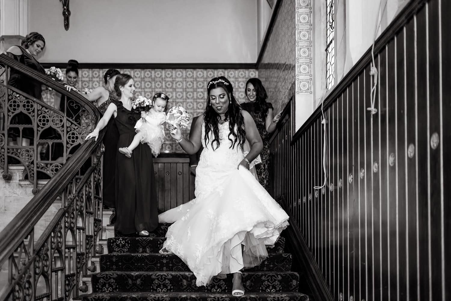 bride walking down the stairs to ceremony