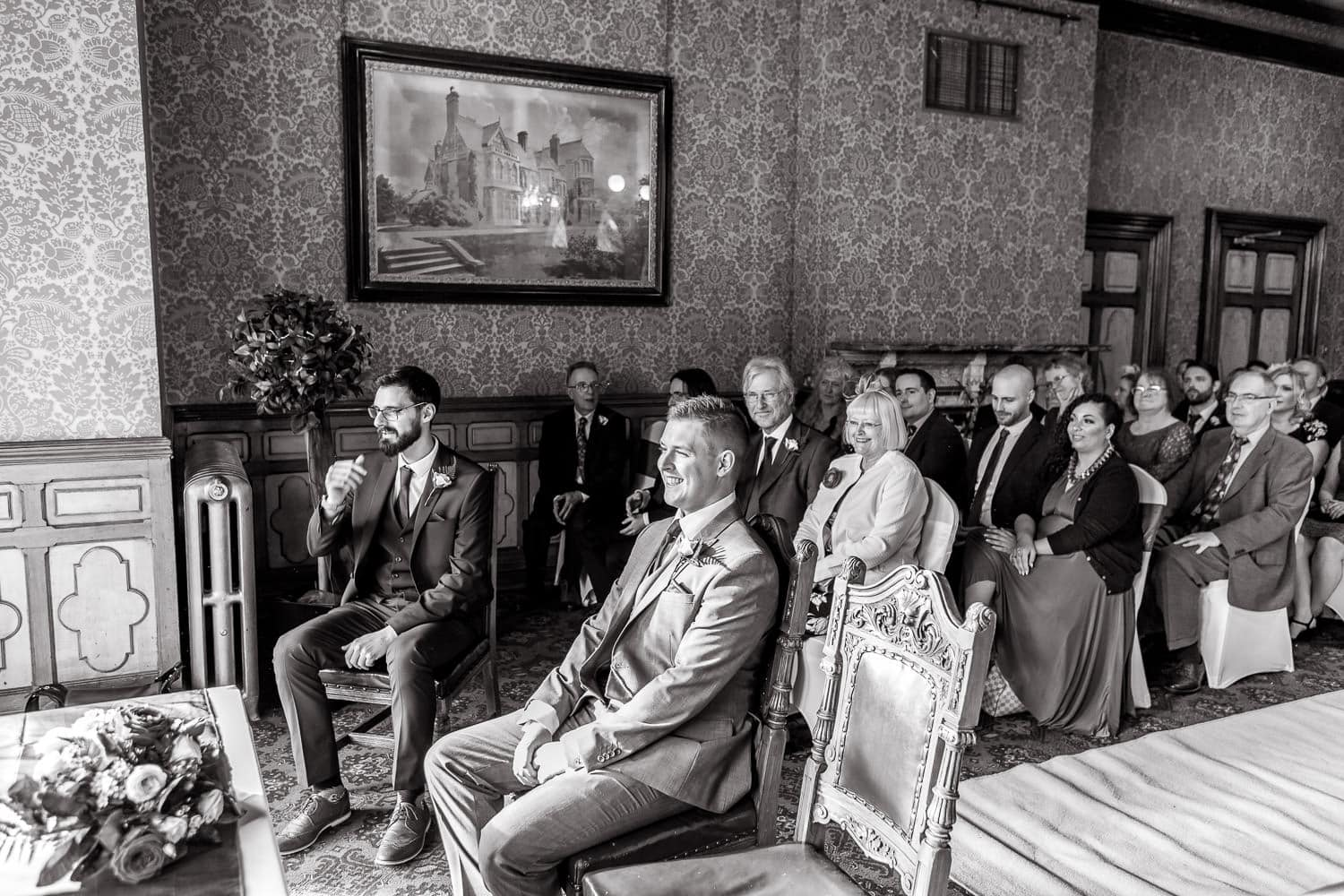 groom looking nervous while he waits for bride to arrive at wedding ceremony