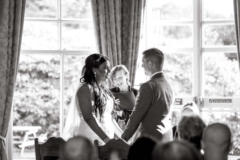 Highbury hall wedding photography captures couple holding hands during ceremony