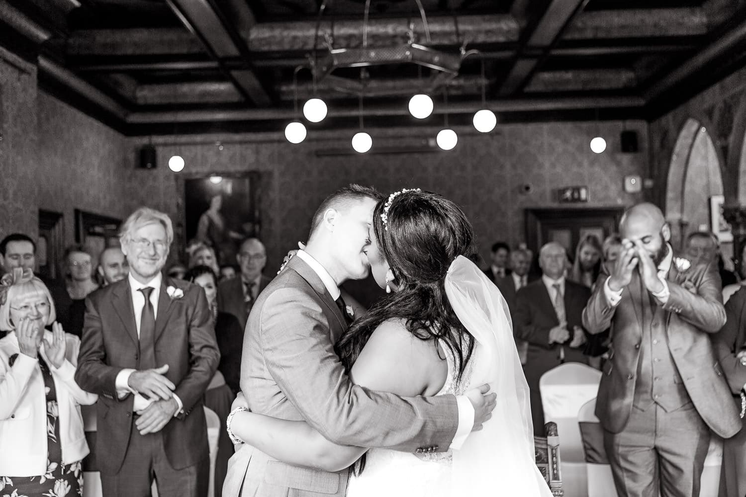 bride and groom kiss as they are announced husband and wife
