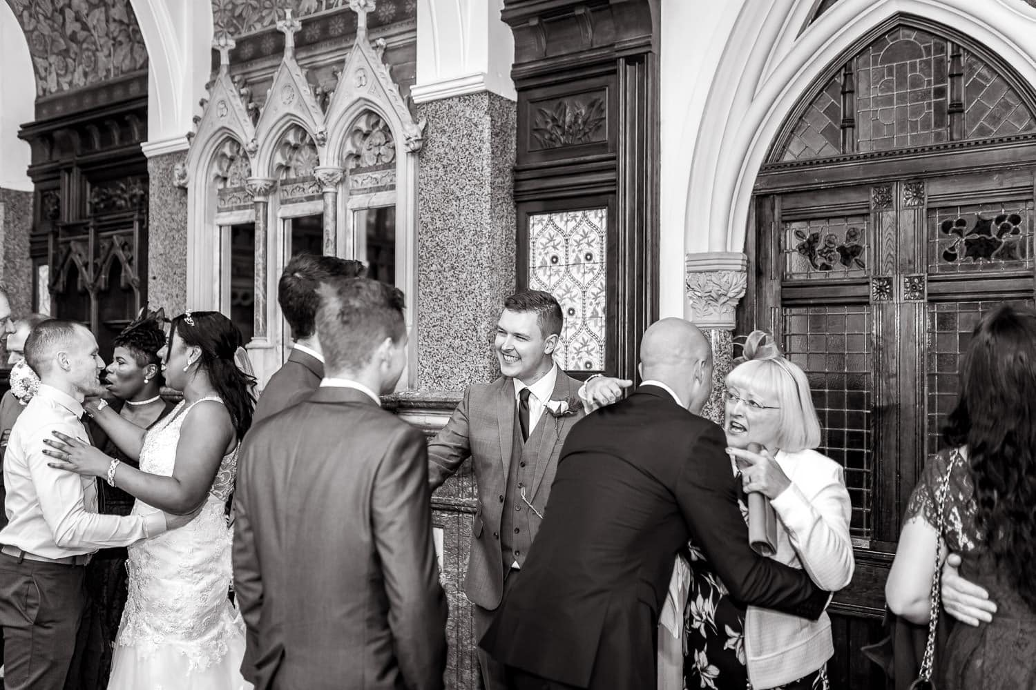 guests and family greet each other at wedding receiving line