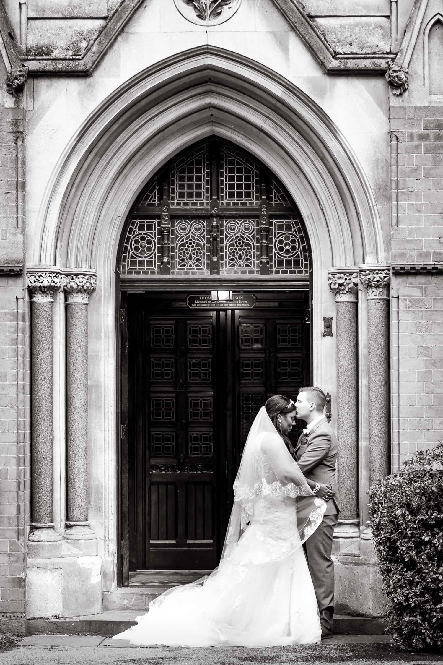 Bride and Groom pose in front of Highbury Hall in Birmingham