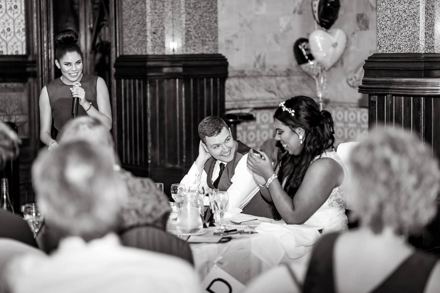 bride claps with delight during speeches