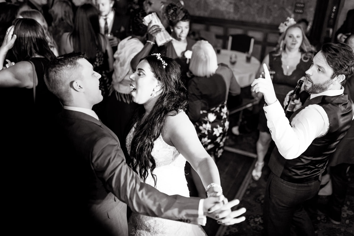 bride and groom singing to each other on the dancefloor