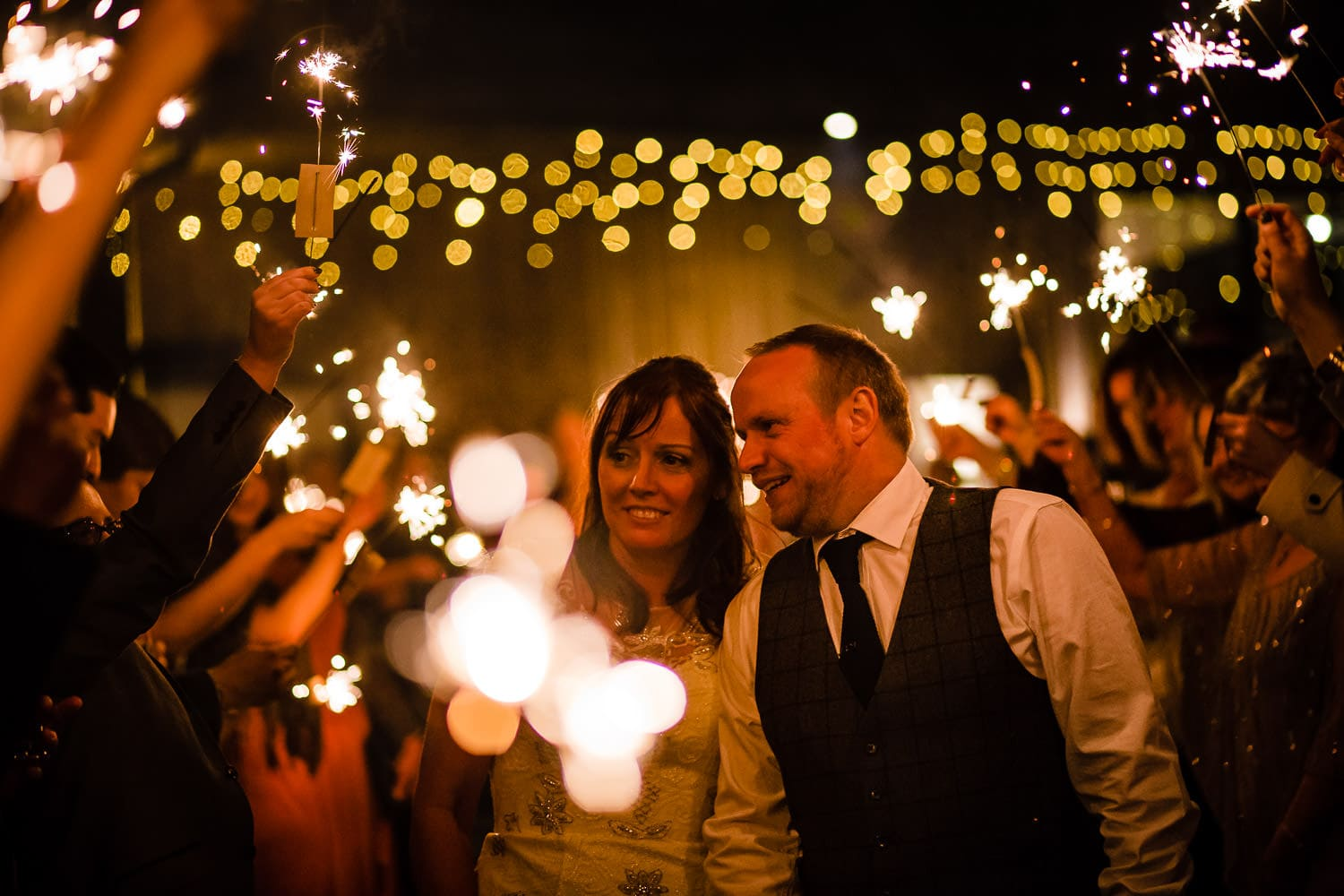 Hothorpe Hall and The Woodlands Wedding Photography captures newlyweds with sparklers