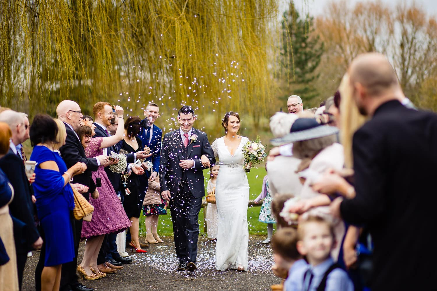 Northamptonshire Wedding Photography captures couple showered with confetti