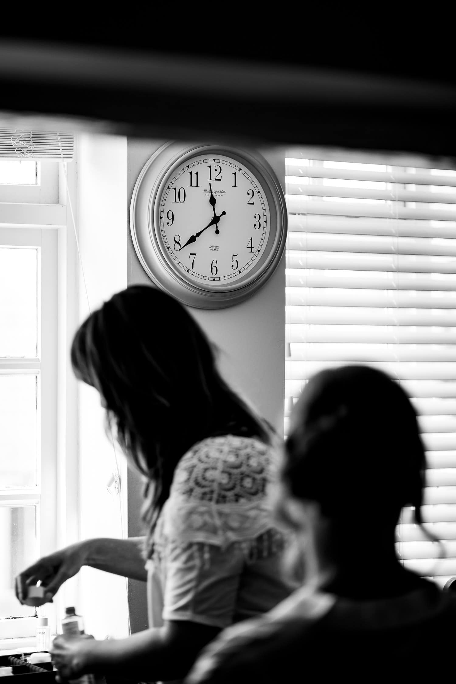 Warwick House Wedding Photography silhoutte picture of bride with clock in the background