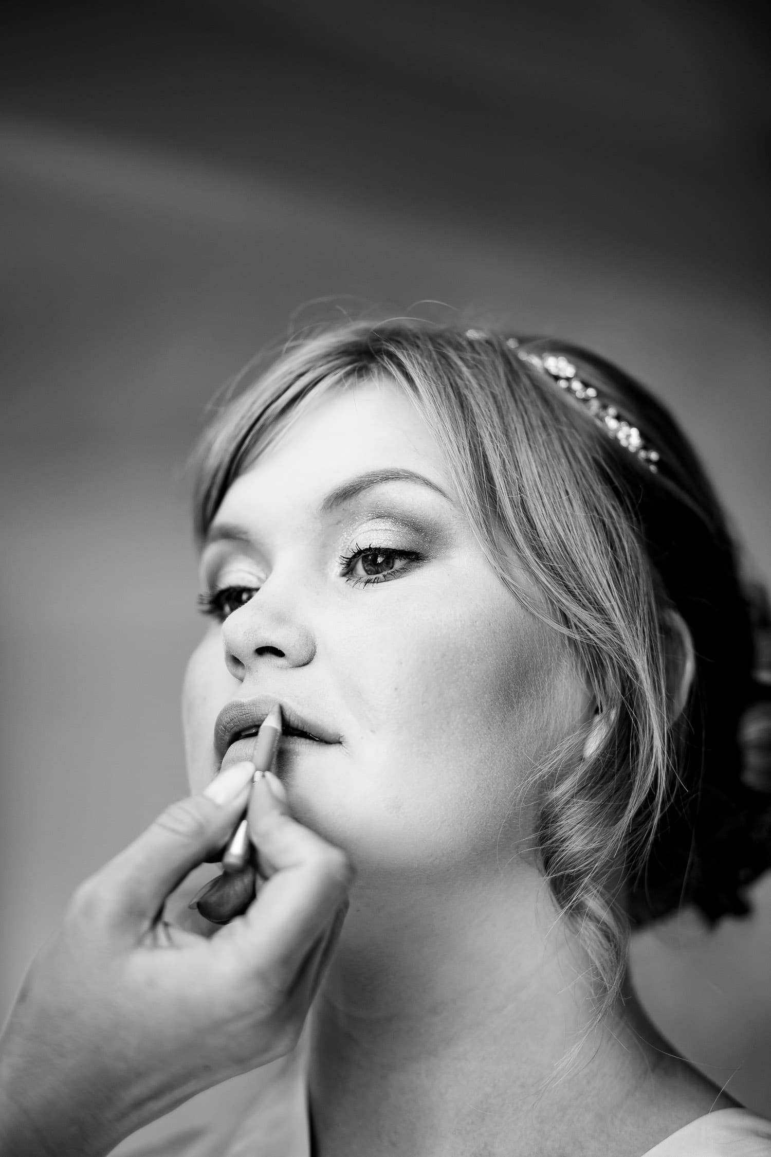 beautiful portrait of bride having makeup applied by Warwick House Wedding Photography