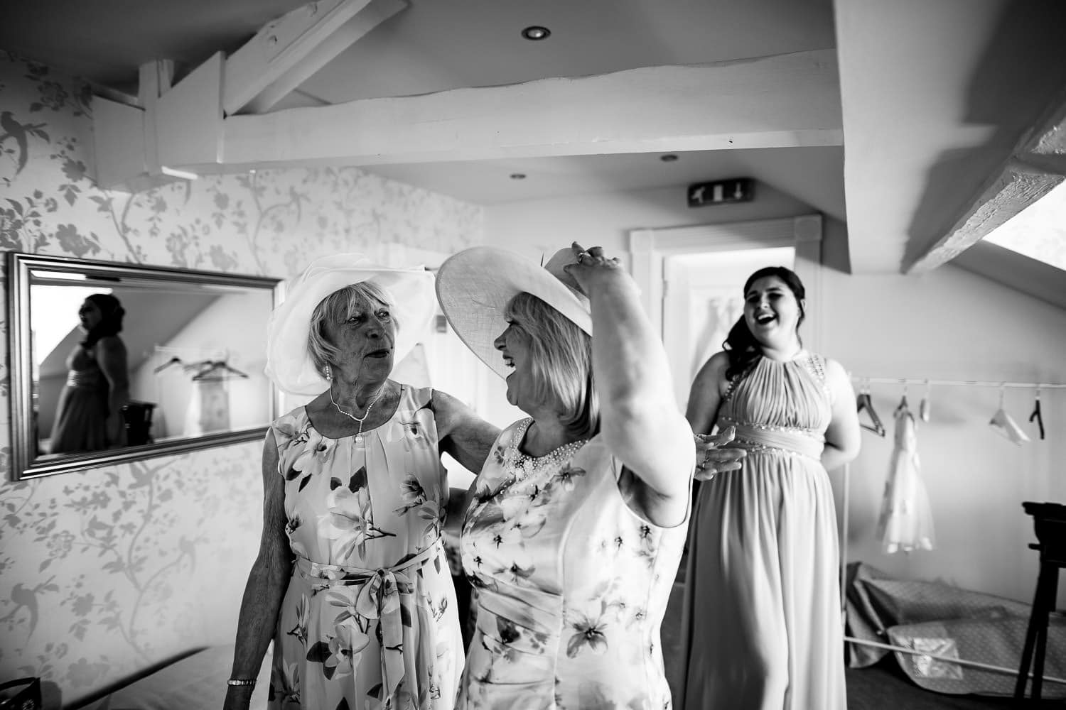 Warwick House Wedding Photography captures brides mom and grandmother laughing together