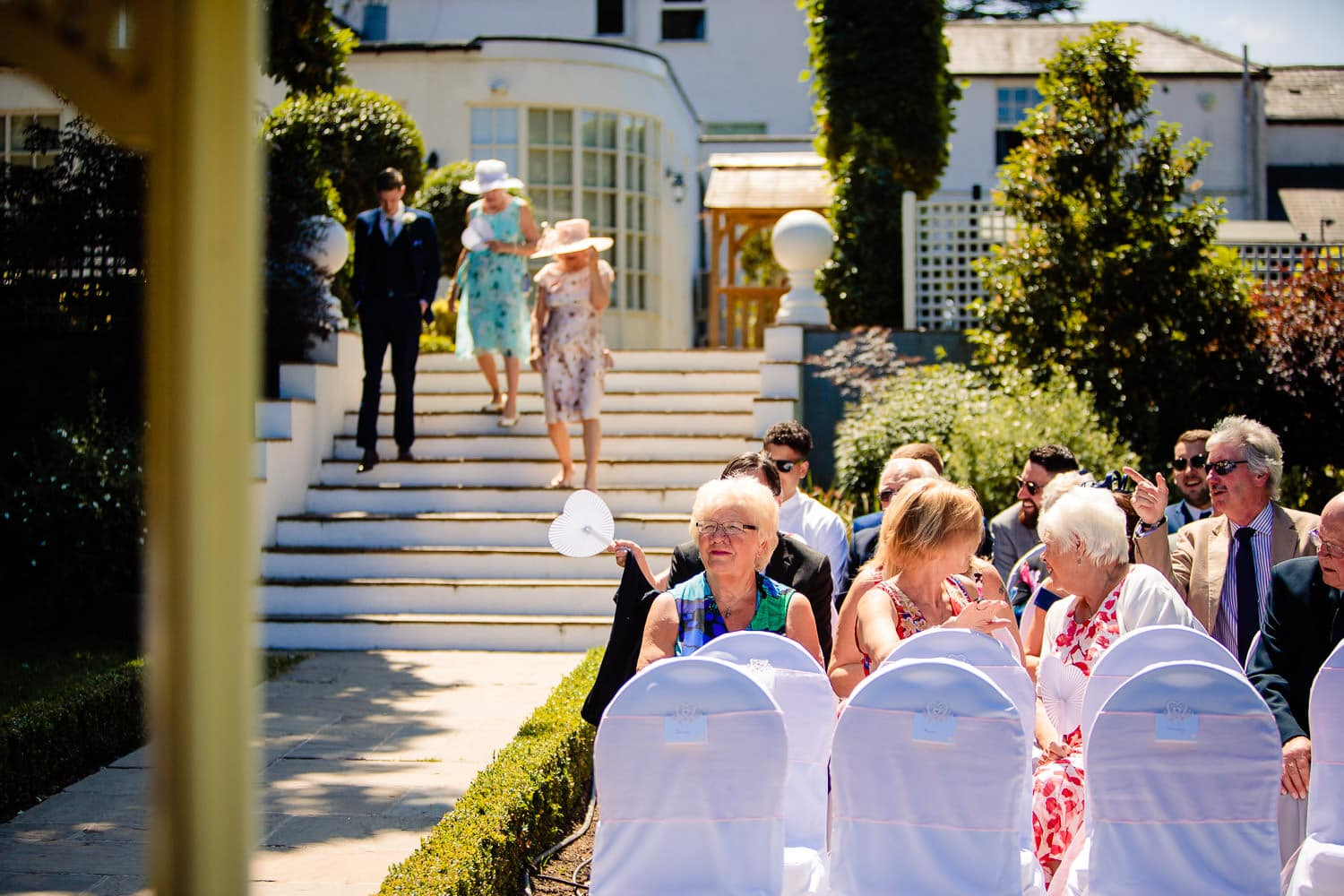 Warwick House Wedding Photography captures guests being seated for outdoor wedding ceremony