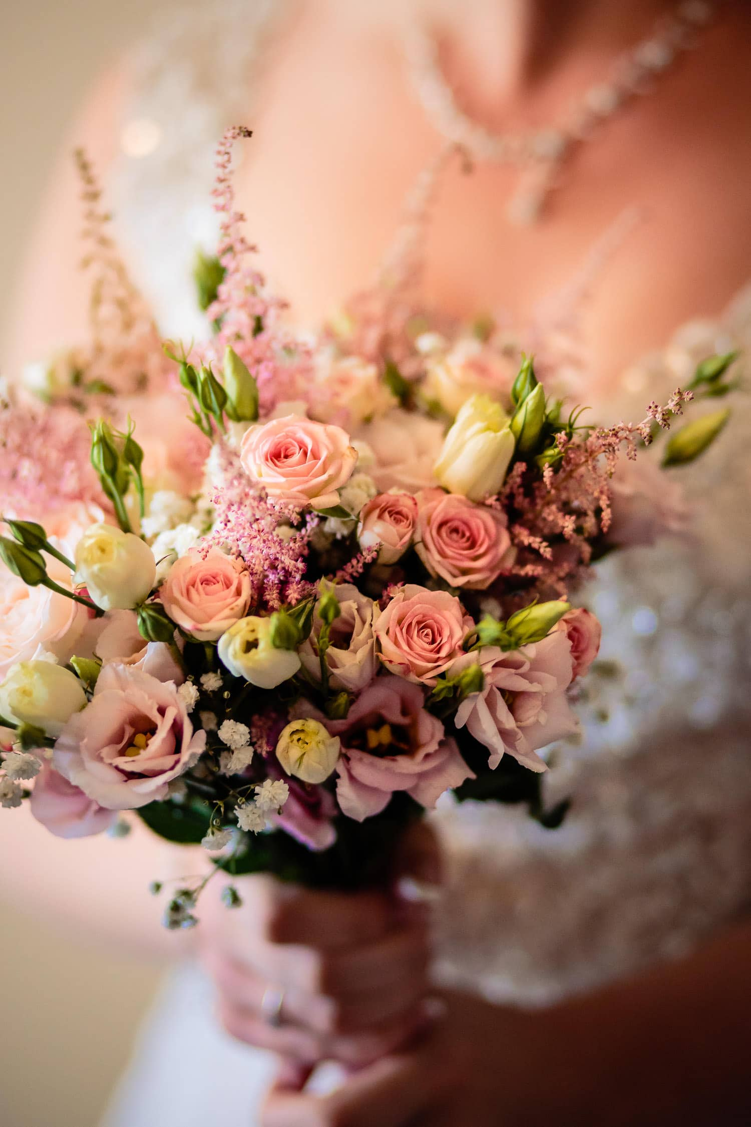 Warwick House Wedding Photography captures brides pretty pastel pink boquet