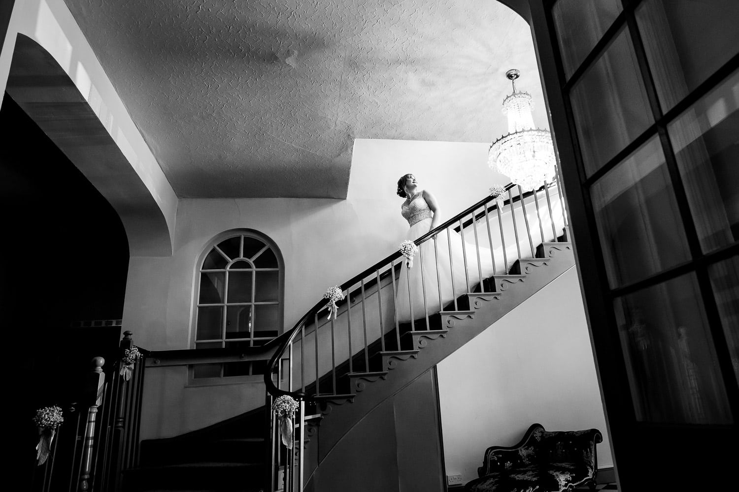 chapter one photography captures bride coming down the stairs during Warwick House Wedding Photography session