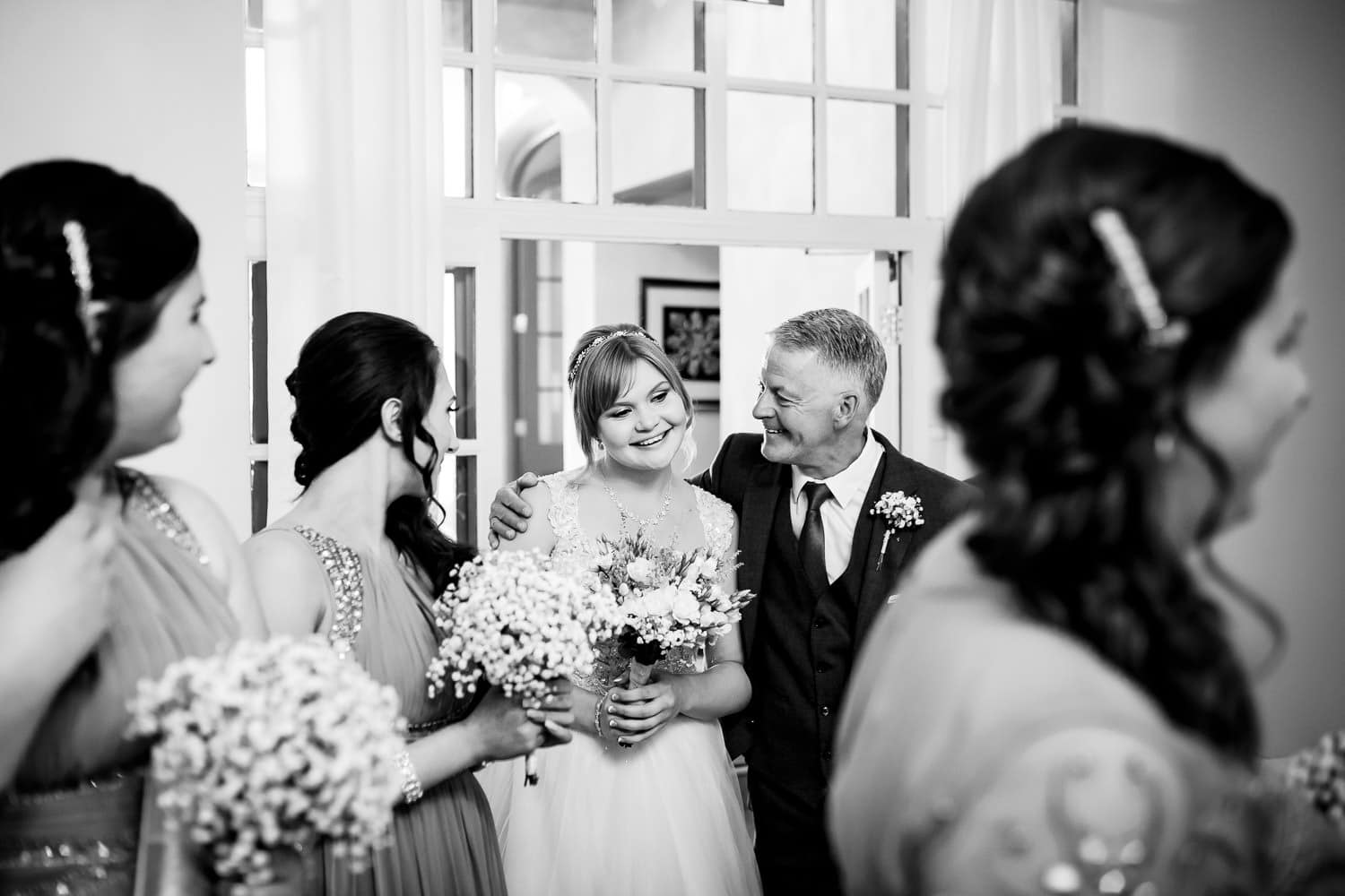 dad giving his daughter a loving hug captured by Warwick House Wedding Photography