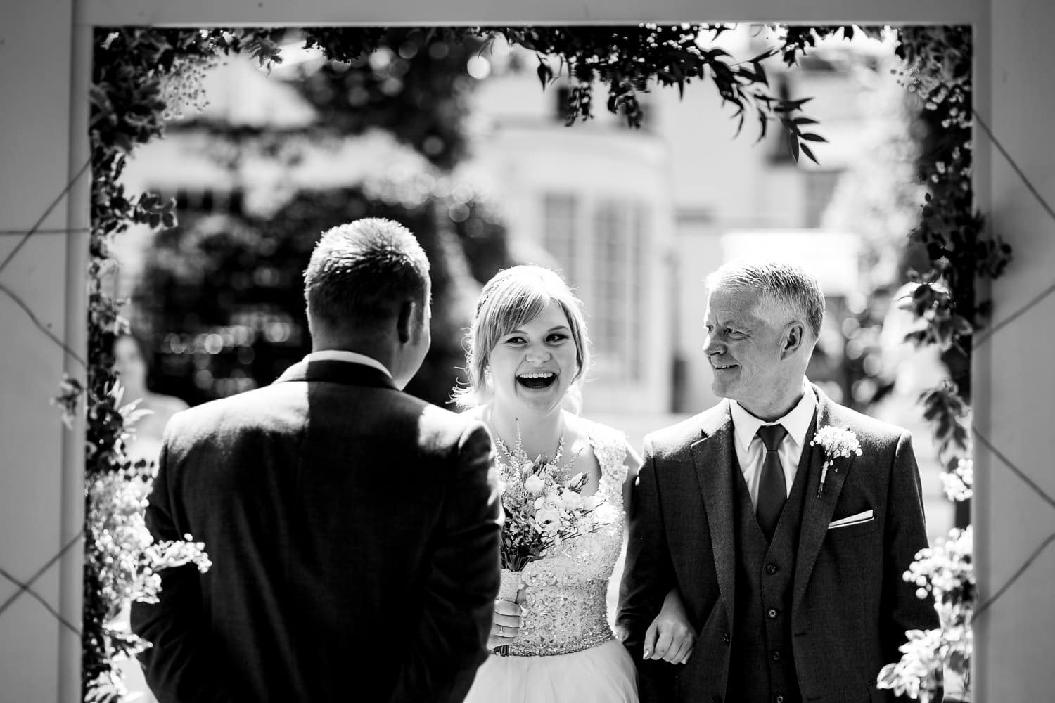 bride and groom first look captured by Warwick House Wedding Photography