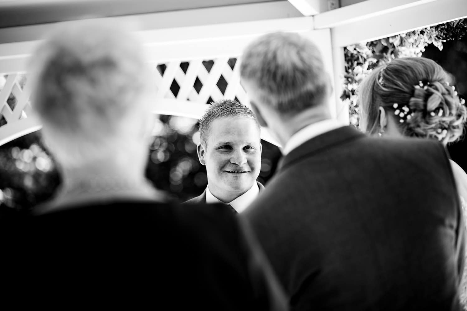 happy groom and proud dad captured by Warwick House Wedding Photography